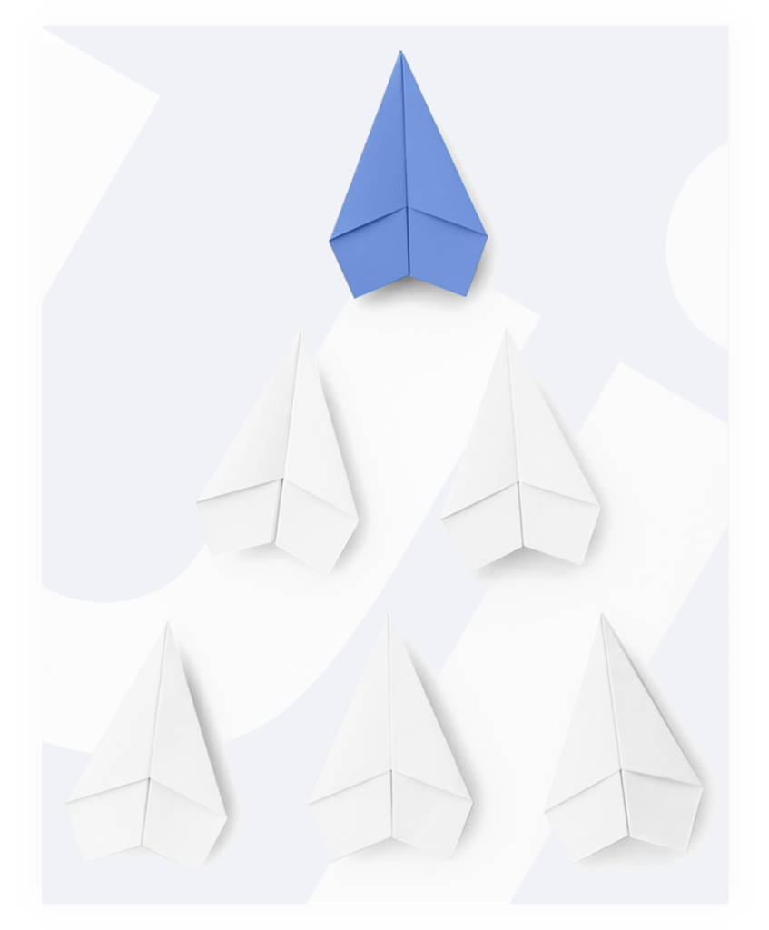 Paper airplanes arranged in a triangle
